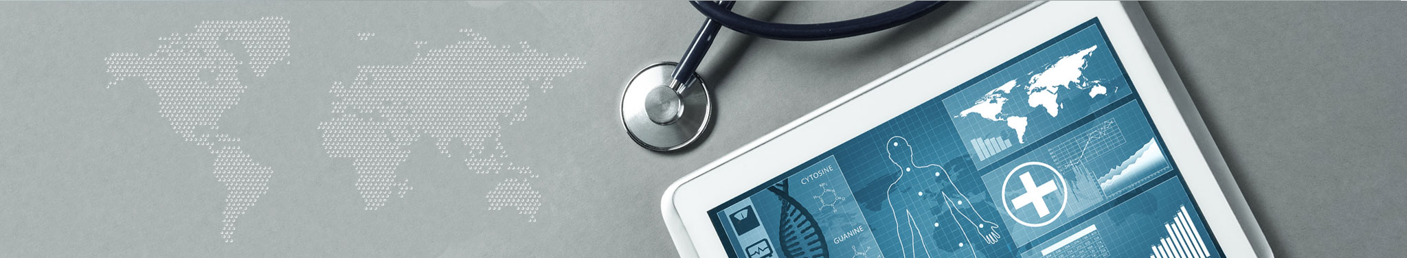 Stethoskop und Tablet auf grauem Tisch
